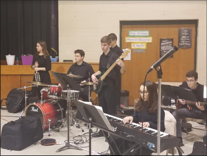 Jazz I Students spread holiday cheer in local primary schools