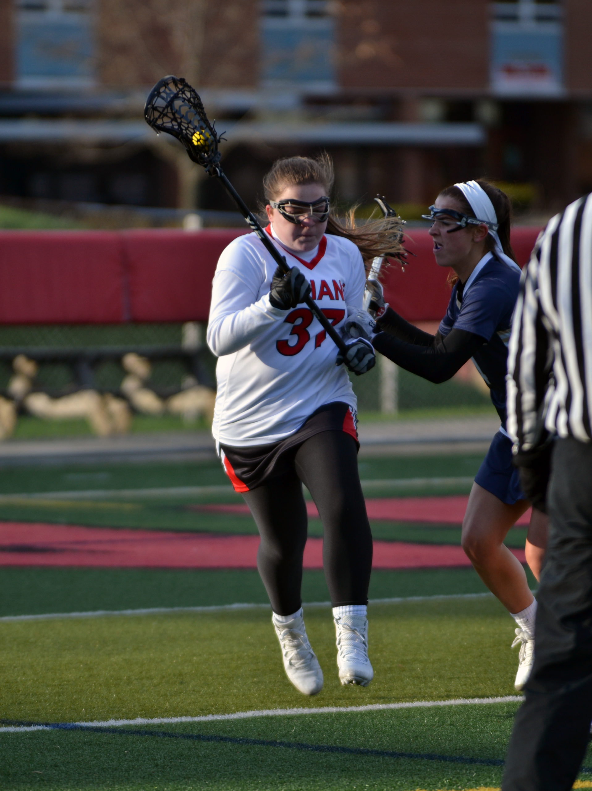 Girls lacrosse faces-off against tough competition